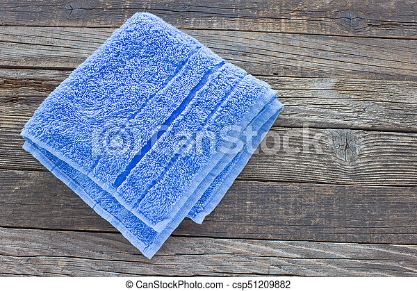 Blue towel on wooden background - csp51209882