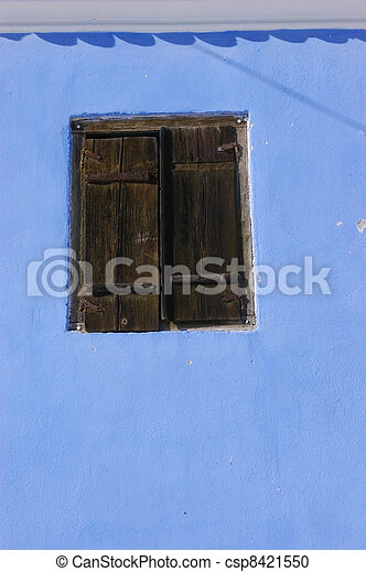 Blue wall with a wooden window    - csp8421550