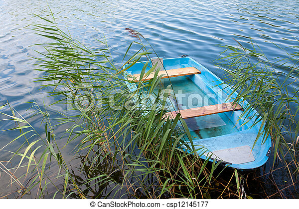 Blue wooden boat on lake - csp12145177