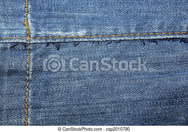 Blue worn jeans with yellow stitches close up. Background or backdrop. - csp2010790