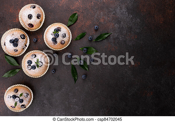 Blueberry muffins on wood background - csp84702045