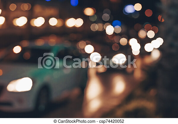 Blurred background with lights of cars in traffic jam. Abstract background with cars on night street. - csp74420052