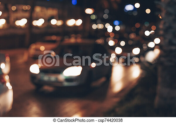 Blurred background with lights of cars in traffic jam. Abstract background with cars on night street. - csp74420038