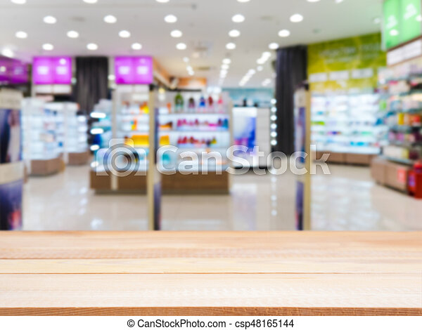Light wooden board empty table in front of blurred background. Perspective light wood over blur in supermarket - can be used for display or montage your products. Mockup for display of product.