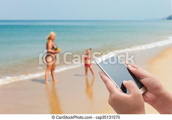 Blurred blue sea and white sand beach - csp35131570