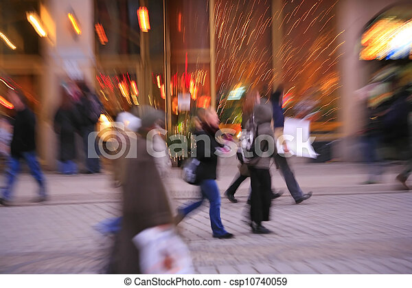 Blurred in-camera effect of people in the city - csp10740059