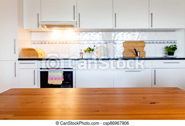 blurred kitchen interior with desk space - csp86967906