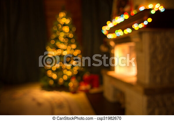 Blurred living room with fireplace and decorated Christmas tree background - csp31982670