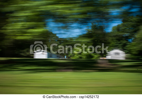 blurred out country landscape while driving - csp14252172