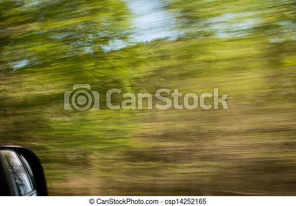 blurred out country landscape while driving - csp14252165