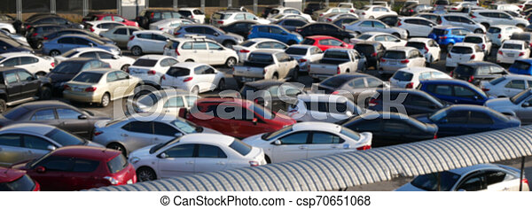 blurred outdoor parking lot full of cars - csp70651068