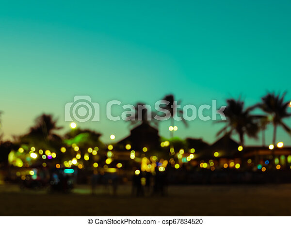 Blurred silhouette sunset beach resort with palm tree - csp67834520