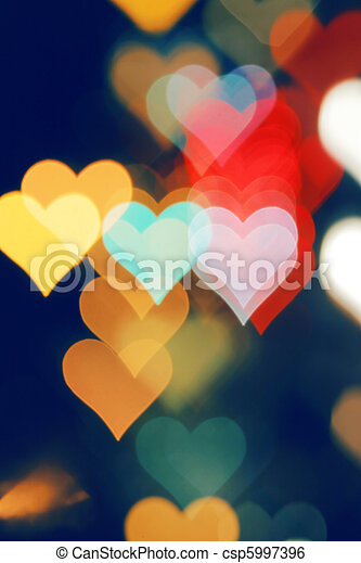 Blurred valentine background with heart-shaped highlights. - csp5997396