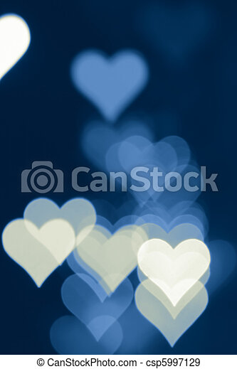 Blurred valentine background with heart-shaped highlights. - csp5997129