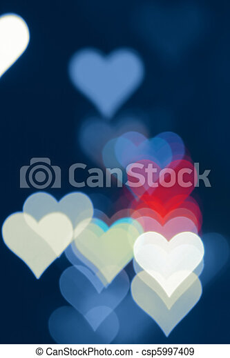 Blurred valentine background with heart-shaped highlights. - csp5997409