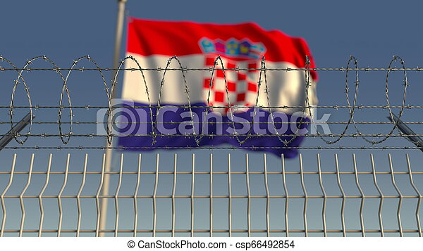 Blurred waving flag of Croatia behind barbed wire fence. 3D rendering - csp66492854