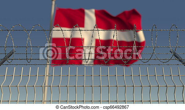 Blurred waving flag of Denmark behind barbed wire fence. 3D rendering - csp66492867