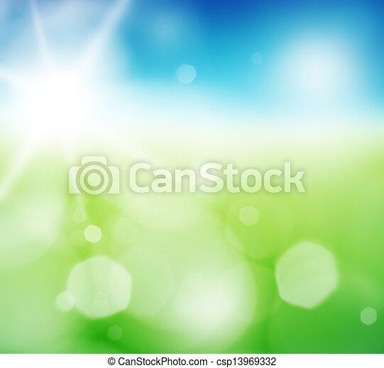 Blurry green field and blue sky with summer sun burst. - csp13969332