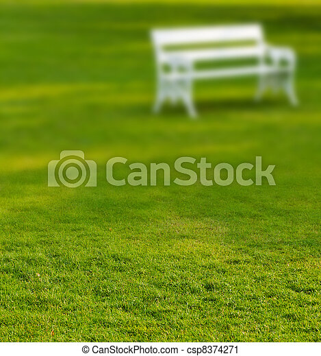 Blurry Long white bench in the park - csp8374271