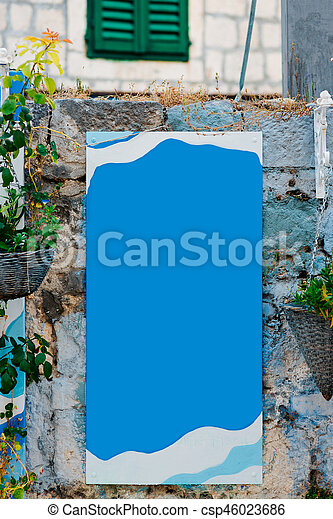 Board for inscriptions on the wall of a building - csp46023686
