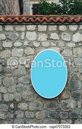 Board for inscriptions on the wall of a building - csp47073353