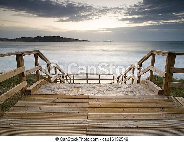 Boardwalk in the beach - csp16132549
