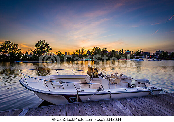 Boat and dock at sunset at the Charles River Esplanade, in Boston, Massachusetts. - csp38642634