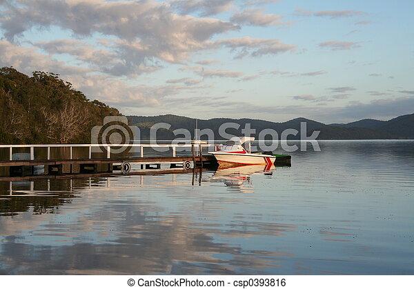 Boat at sunrise - csp0393816