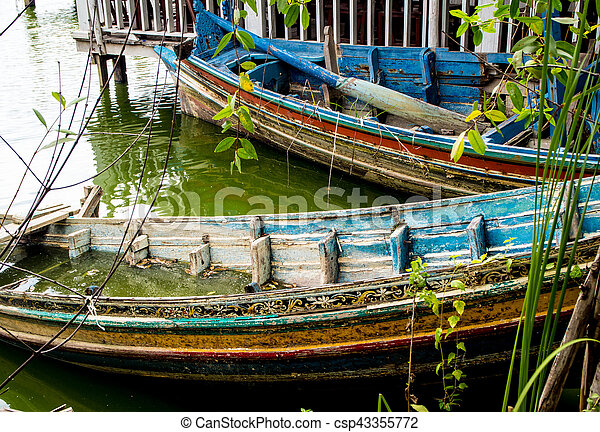 Boat decaying and drowned in lake - csp43355772