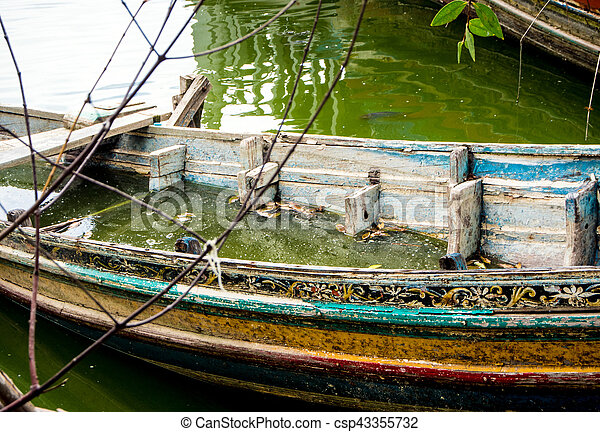Boat decaying and drowned in lake - csp43355732