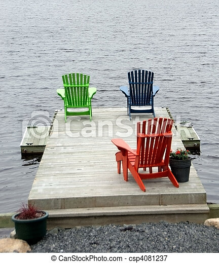 Boat Dock With Adirondack Chairs Stock Photo
