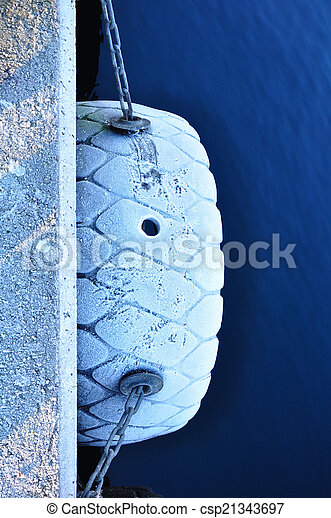 Boat fender with snow. - csp21343697