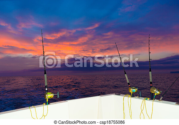 boat fishing trolling at sunset with rods and reels - csp18755086