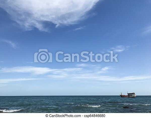 Boat in the blue sea with blue sky background - csp64846680