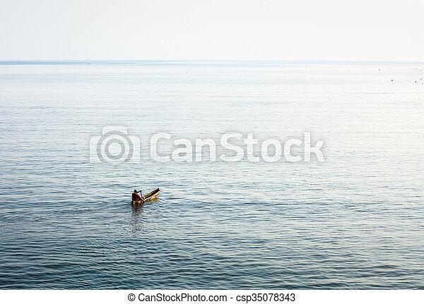 Boat in the ocean - csp35078343