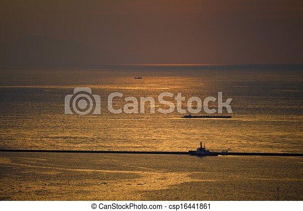 boat in the ocean sunset - csp16441861