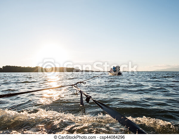Boat in the ocean with sunset - csp44084296