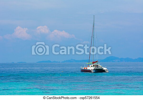 Boat is boarding on the vivid blue sea with blue sky - csp57261554