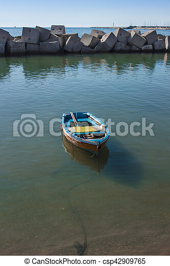 Boat moored in the port of Salerno in a sea green waters. - csp42909765