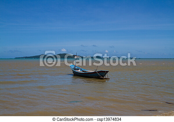 Boat on the beach. - csp13974834