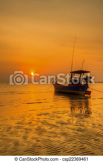 boat on the ocean at sunset - csp22369461