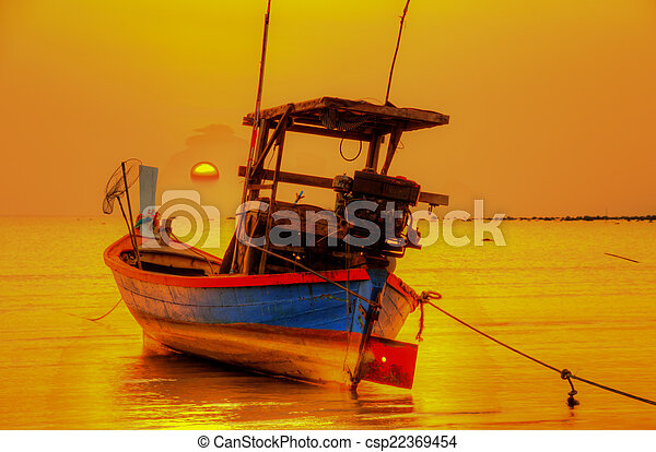 boat on the ocean at sunset - csp22369454