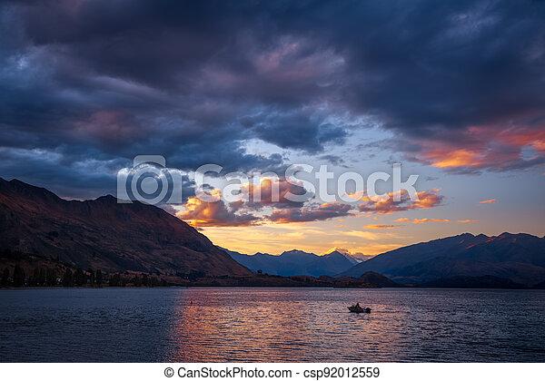 Boat on the water at sunset at Lake Wanaka - csp92012559