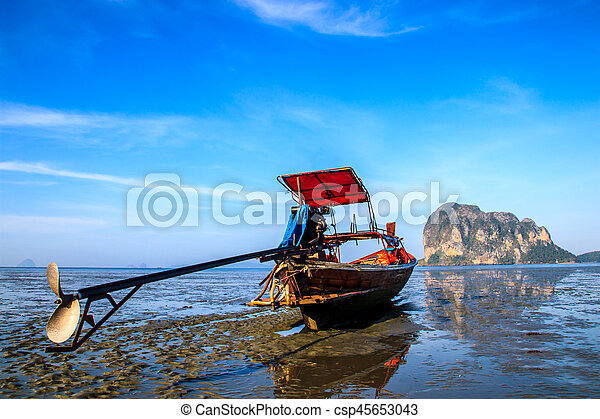 Boat stand on the beach during low tide with blue sky - csp45653043