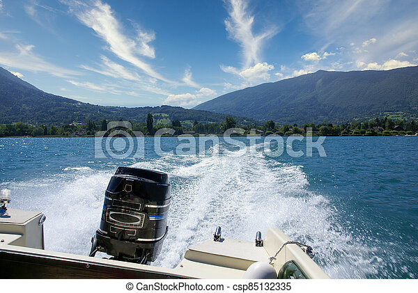 Boat white wake on the blue lake of Annecy, France - csp85132335