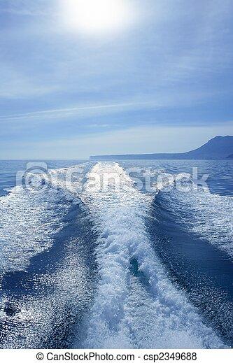 Boat white wake on the blue ocean sea - csp2349688