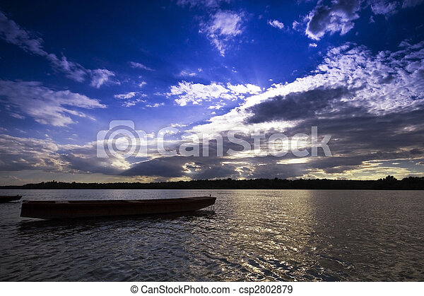 Boats at sunset on the Danube river - csp2802879
