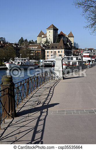 Boats, city and castle of Annecy - csp35535664