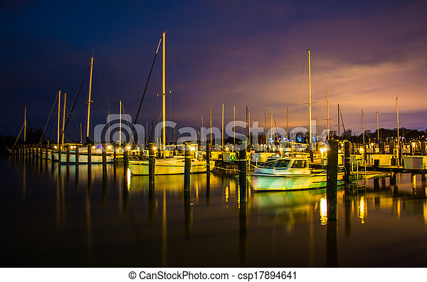 Boats in a marina at night, in Havre de Grace, Maryland