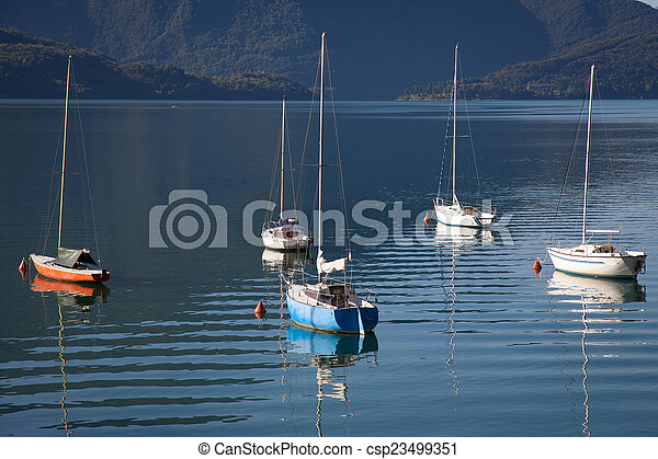 Boats in a summer day on Lake Como, Italy - csp23499351